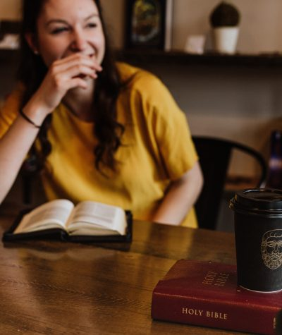 girl in coffee shop with Bible